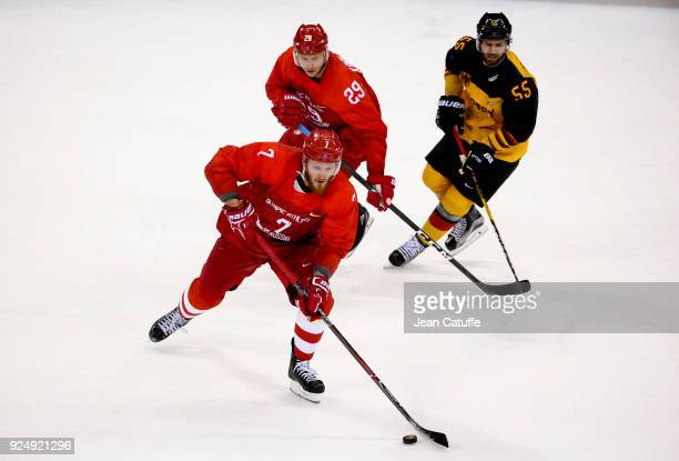 Ivan Telegin, Ilya Kablukov of Olympic Athlete from Russia, Felix Schutz of Germany during the Men's Ice Hockey Gold Medal match between Germany and...