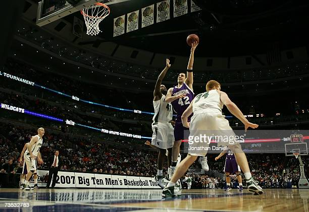 Ivan Tolic of the Northwestern Wildcats attempts a shot against Marquise Gray and Drew Naymick of the Michigan State Spartans during Day 1 of the Big...