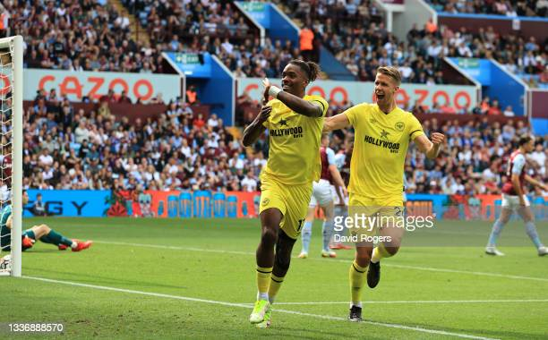 Ivan Toney of Brentford celebrates after scoring their sides first goal during the Premier League match between Aston Villa and Brentford at Villa...