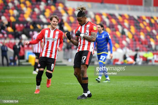Ivan Toney of Brentford celebrates after scoring their team's first goal from the penalty spot during the Sky Bet Championship match between...