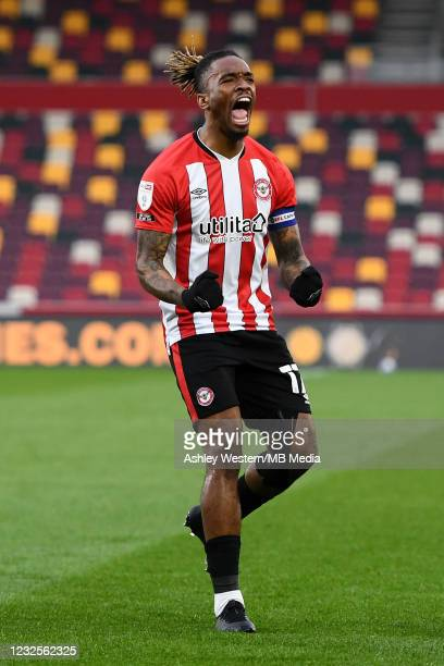 Ivan Toney of Brentford celebrates as Bryan Mbeumo scores the opening goal during the Sky Bet Championship match between Brentford and Rotherham...