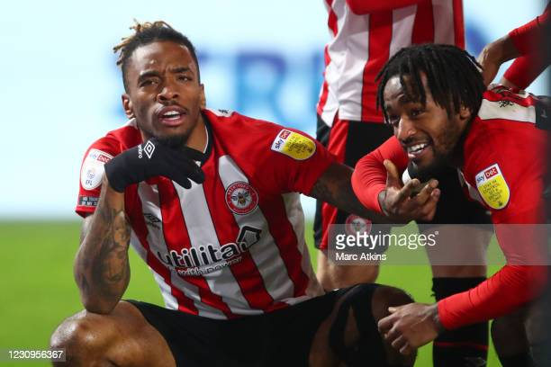 Ivan Toney of Brentford celebrates scoring their 2nd goal with Tariq Fosu during the Sky Bet Championship match between Brentford and Bristol City at...