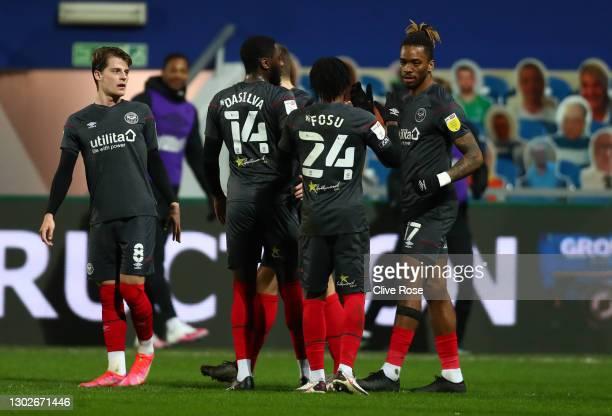 Ivan Toney of Brentford celebrates with Mathias Jensen, Josh Dasilva and Tariqe Fosu after scoring his team's first goal during the Sky Bet...