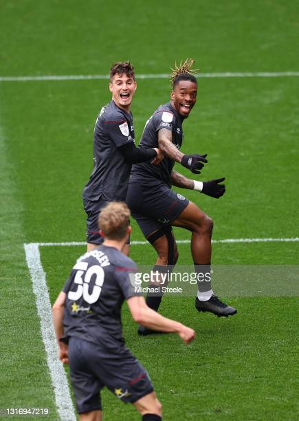 Ivan Toney of Brentford celebrates with Sergi Canos after scoring their side's first goal during the Sky Bet Championship match between Bristol City...
