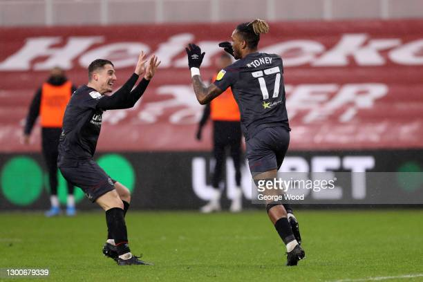 Ivan Toney of Brentford celebrates with teammate Sergi Canos after scoring his team's first goal during the Sky Bet Championship match between...