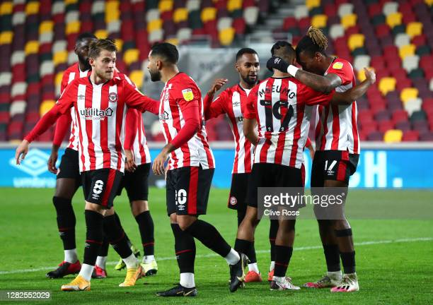 Ivan Toney of Brentford celebrates with teammates after scoring his sides first goal during the Sky Bet Championship match between Brentford and...