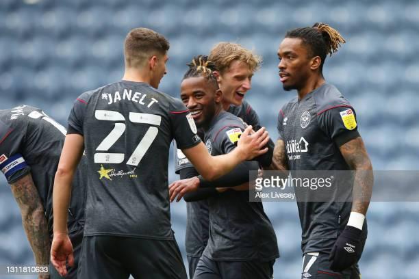 Ivan Toney of Brentford celebrates with Vitaly Janelt after scoring their team's third goal during the Sky Bet Championship match between Preston...