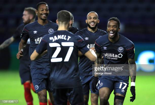 Ivan Toney of Brentford FC celebrates with teammates after scoring his sides second goal during the Sky Bet Championship match between Sheffield...