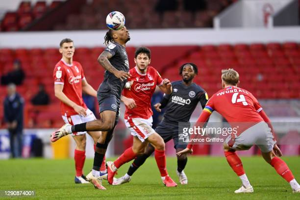 Ivan Toney of Brentford heads the ball under pressure from Tobias Figueiredo of Nottingham Forest during the Sky Bet Championship match between...