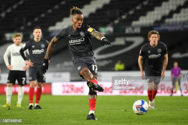 Ivan Toney of Brentford scores their side's first goal from the penalty spot during the Sky Bet Championship match between Derby County and Brentford...