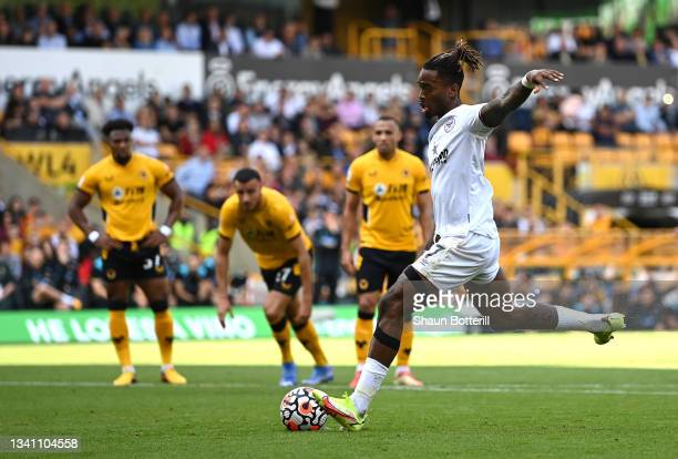 Ivan Toney of Brentford scores their side's first goal from the penalty spot during the Premier League match between Wolverhampton Wanderers and...