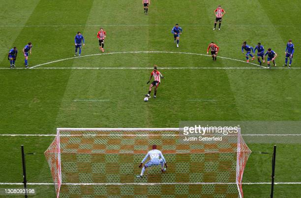Ivan Toney of Brentford scores their team's first goal from the penalty spot past Brice Samba of Nottingham Forest during the Sky Bet Championship...