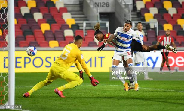 Ivan Toney of Brentford scores their team's second goal while challenged by Nicholas Hamalainen of Queens Park Rangers during the Sky Bet...