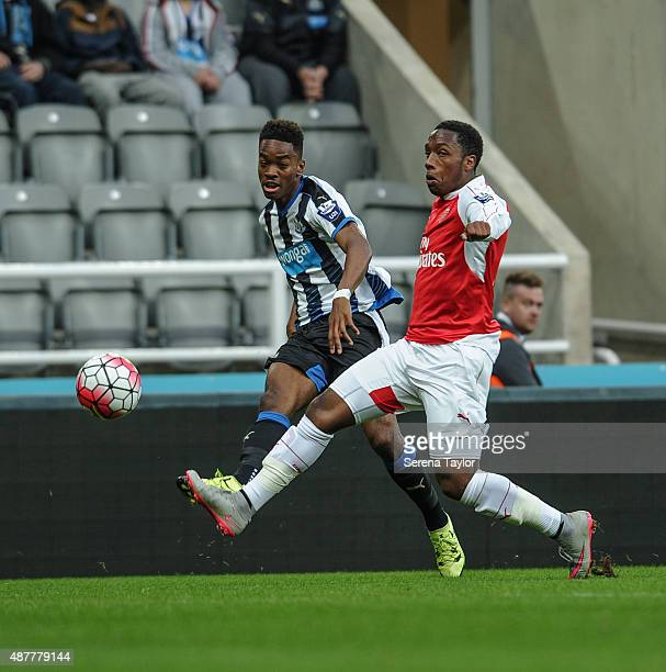Ivan Toney of Newcastle crosses the ball past Arsenal player Kaylen Hinds during the U21 Premier league match between Newcastle United and Arsenal at...