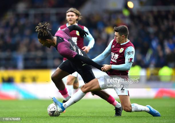 Ivan Toney of Peterborough United is challenged by Matthew Lowton of Burnley during the FA Cup Third Round match between Burnley FC and Peterborough...