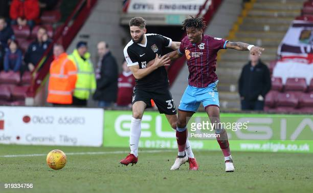 Ivan Toney of Scunthorpe United contests the ball with Jordan Turnbull of Northampton Town during the Sky Bet League One match between Scunthorpe...