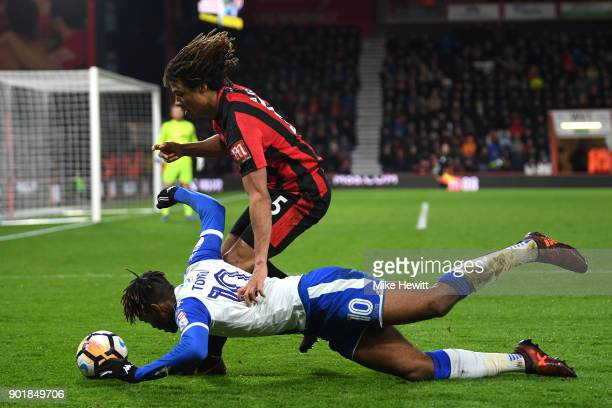 Ivan Toney of Wigan Athletic tackles Nathan Ake of AFC Bournemouth during The Emirates FA Cup Third Round match between AFC Bournemouth and Wigan...