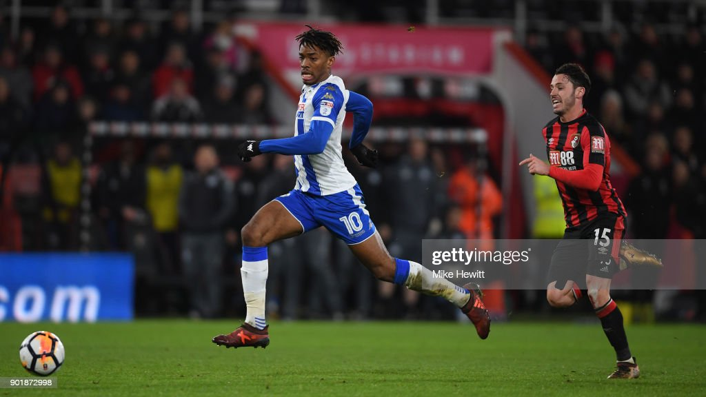 Ivan Toney of Wigan gets away from Adam Smith of Bournemouth during The Emirates FA Cup Third Round match between AFC Bournemouth and Wigan Athletic at Vitality Stadium on January 6, 2018 in Bournemouth, England.