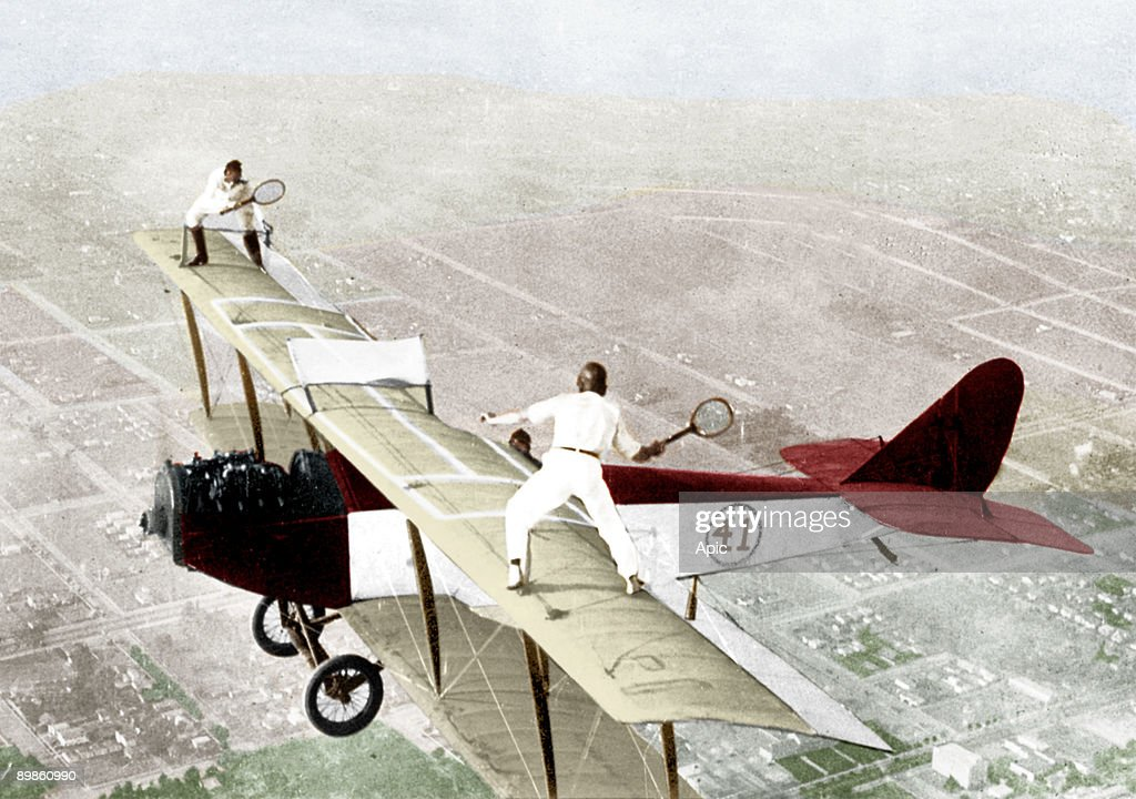 Ivan Unger and Gladys Roy playing tennis on the roof of a flying plane 1925 colorized document : News Photo