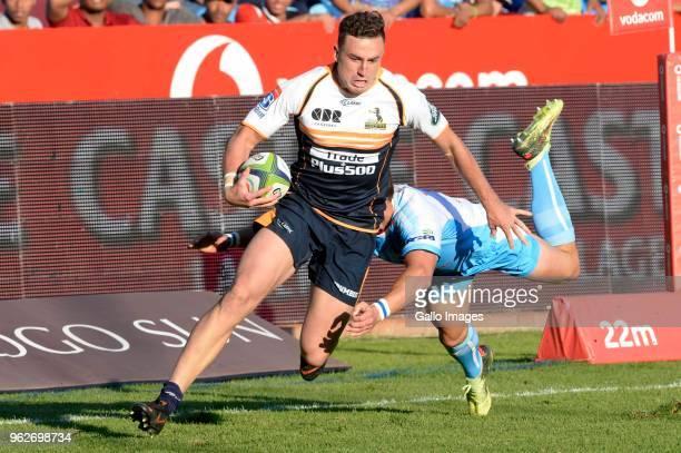 Ivan van Zyl of the Bulls miss tackles Tom Banks of the Brumbies during the Super Rugby match between Vodacom Bulls and Brumbies at Loftus Versfeld...