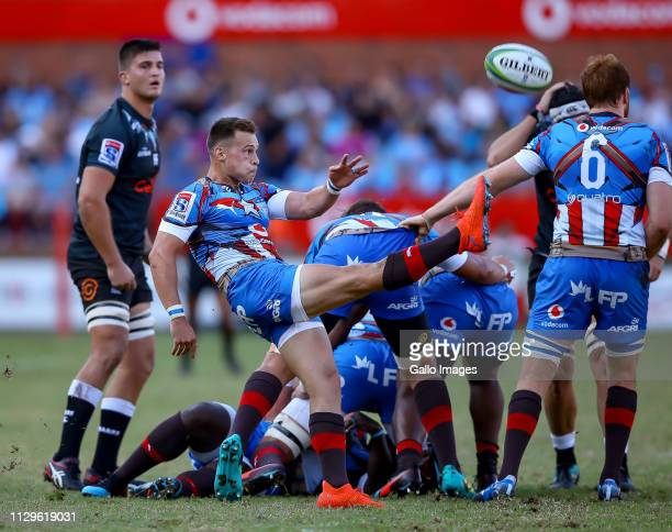 Ivan van Zyl of the Vodacom Bulls clears the base during the Super Rugby match between Vodacom Blue Bulls and Cell C Sharks at Loftus Versfeld on...