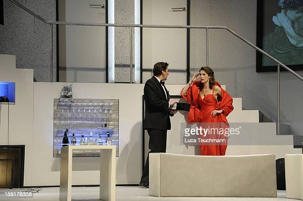 Ivan Vrgoc and Julia Bremermann perform during the 'Geruechte...Geruechte...' photo rehearsal at Komoedie am Kurfuerstendamm Theater on January 9,...