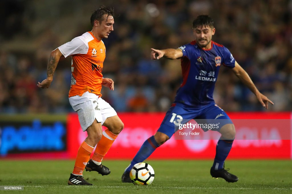 Ivan Vujica of the Jets and Eric Bautheac of the Roar contest the ball during the round 16 A-League match between the Newcastle Jets and the Brisbane Roar at McDonald Jones Stadium on January 12, 2018 in Newcastle, Australia.
