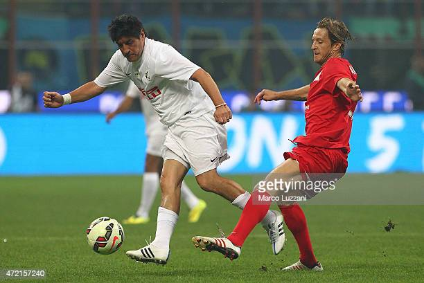 Ivan Zamorano competes for the ball with Massimo Ambrosini during the Zanetti and friends Match for Expo 2015 at Stadio Giuseppe Meazza on May 4 2015...