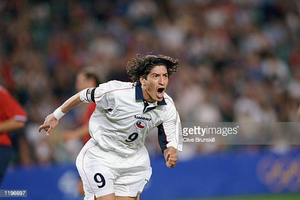 Ivan Zamorano of Chile celebrates one of his two goals during the Olympic Men's Soccer Bronze Medal Game against the United States at Sydney Football...