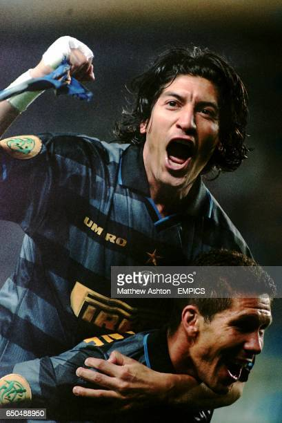Ivan Zamorano of Inter Milan gets a piggy back ride off teammate Diego Simeone as he celebrates winning the UEFA Cup