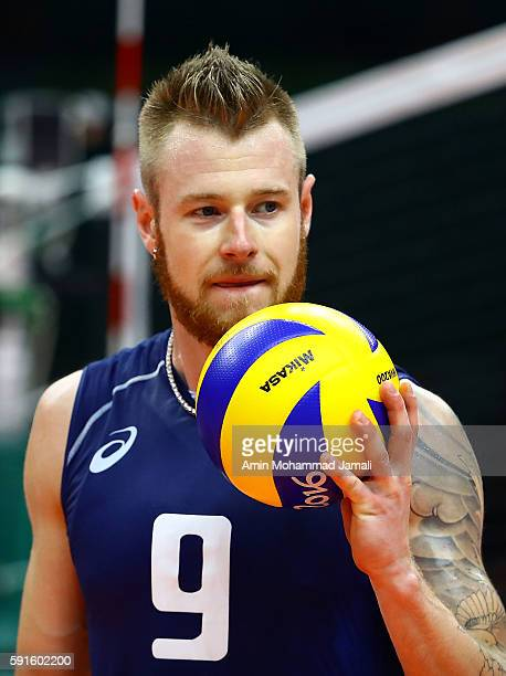 Ivan Zaytsev Of Italy Holds A Ball Against Iran During The Mens Quarterfinal Volleyball Match On