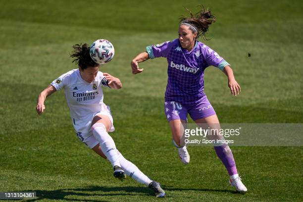 Ivana Andres of Real Madrid Feminas battle for the ball with Mari Paz of Real Betis Feminas during the Primera Iberdrola match between Real Madrid...