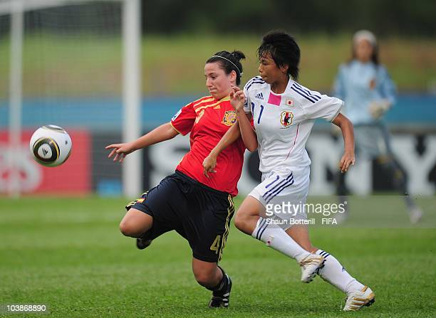 Ivana Andres of Spain is tackled by MinaTanaka of Japan during the FIFA U17 Women's World Cup Group C match between Spain and Japan at the Ato Boldon...