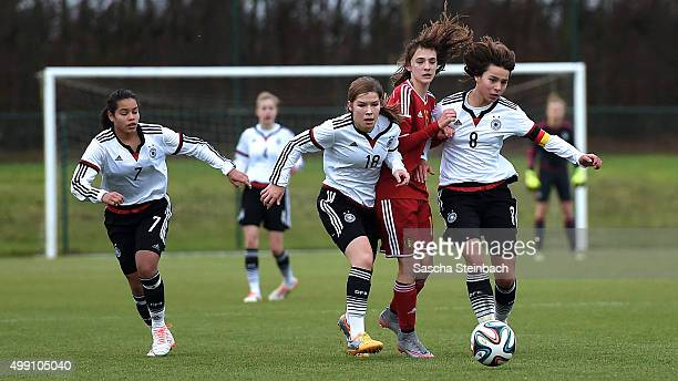 Ivana Fuso Pauline Berning and Lena Sophie Oberdorf of Germany vie with Zenia Mertens of Belgium during the U15 girl's international friendly match...