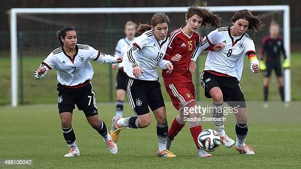 Ivana Fuso Pauline Berning and Lena Sophie Oberdorf of Germany vie with Zenia Mertens of Belgium during the U15 girl's international friendly match...