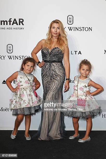 Ivana IlicLabia and daughters walk the red carpet of amfAR Milano 2016 at La Permanente on September 24 2016 in Milan Italy