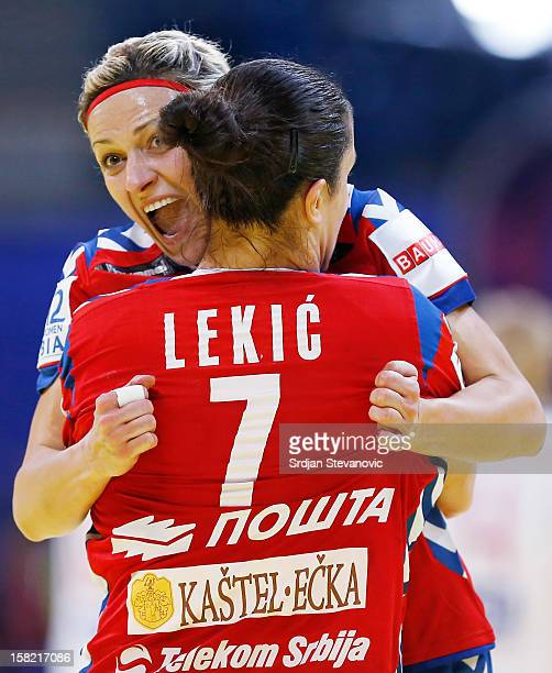 Ivana Milosevic and Andrea Lekic of Serbia celebrate a score during the Women's European Handball Championship 2012 Group I main round match between...