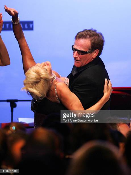 Ivana Trump and Robin Williams during amfAR's Cinema Against AIDS Benefit in Cannes, Presented by Bold Films, Palisades Pictures and The Weinstein...