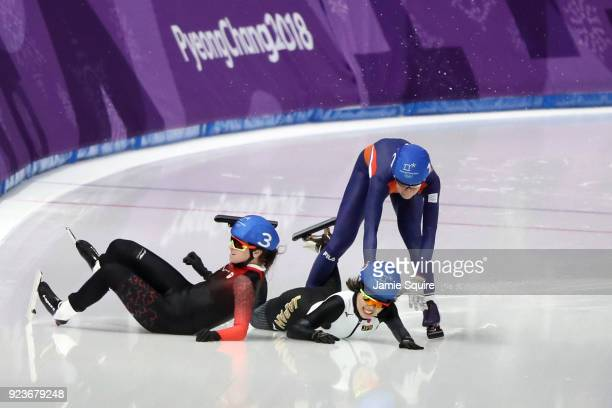 Ivanie Blondin of Canada Ayano Sato of Japan and Annouk Van Der Weijden of the Netherlands collide during the Ladies' Speed Skating Mass Start...