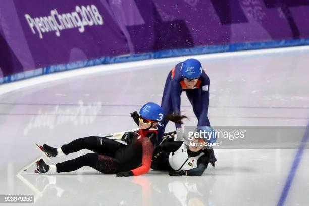 Ivanie Blondin of Canada, Ayano Sato of Japan and Annouk Van Der Weijden of the Netherlands collide during the Ladies' Speed Skating Mass Start...
