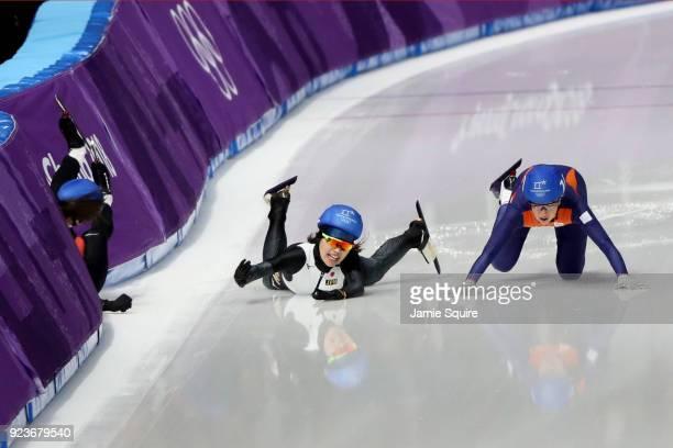 Ivanie Blondin of Canada Ayano Sato of Japan and Annouk Van Der Weijden of the Netherlands crash during the Ladies' Speed Skating Mass Start...