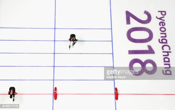 Ivanie Blondin of Canada crosses the line ahead of Claudia Pechstein of Germany during the Women's Speed Skating 3000m on day one of the PyeongChang...