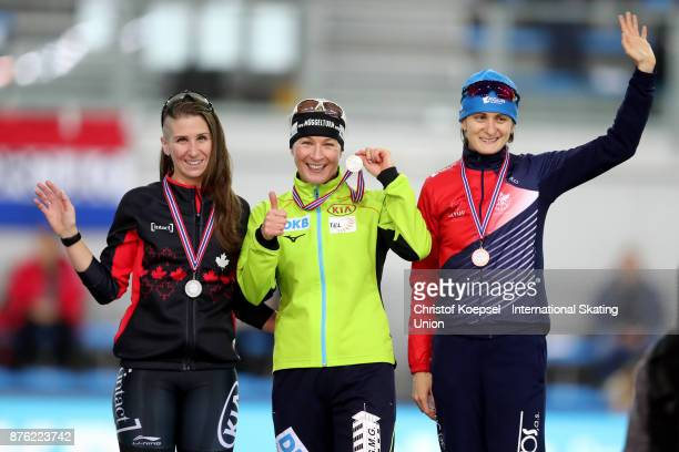 Ivanie Blondin of Canada poses during the medal ceremony after winning the 2nd place Claudia Pechstein of Germany poses during the medal ceremony...