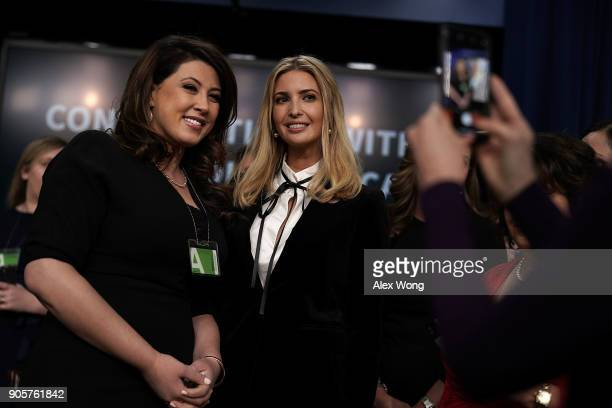 Ivanka Trump Adviser and daughter of President Donald Trump poses for photos with a guest during a Conversations with the Women of America panel at...