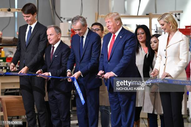 Ivanka Trump, advisor to the US president, US President Donald Trump, Chief Executive of LVMH Bernard Arnault, CEO of Louis Vuitton Michael Burke and...