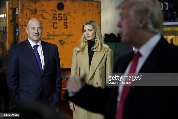 Ivanka Trump and chief economic advisor Gary Cohn listen as US President Donald Trump speaks during a tour of the HK Equipment Company in Coraopolis...