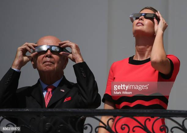 Ivanka Trump and Commerce Secretary Wilbur Ross wear special glasses to look up at the Solar Eclipse, at the White House on August 21, 2017 in...