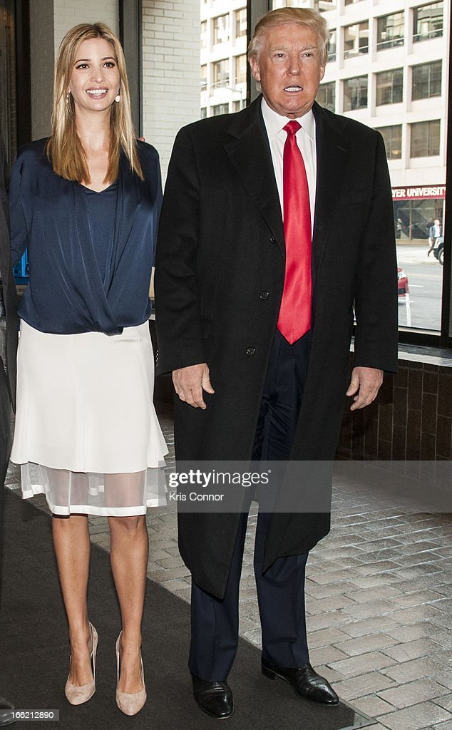 Ivanka Trump and Donald Trump pose for a photo during a forum on 'Washington real estate -- including plans to renovate the landmark Old Post Office on Pennsylvania Avenue and views on property values and trends in Washington.' at Washington Post on April 10, 2013 in Washington, DC.
