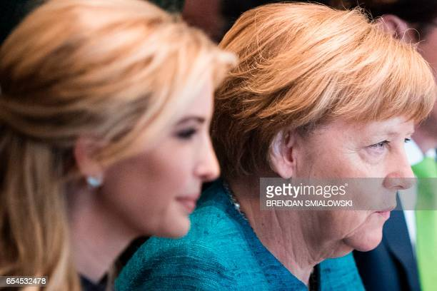 Ivanka Trump and Germany's Chancellor Angela Merkel wait for a meeting with US President Donald Trump and business leaders in the Cabinet Room of the...