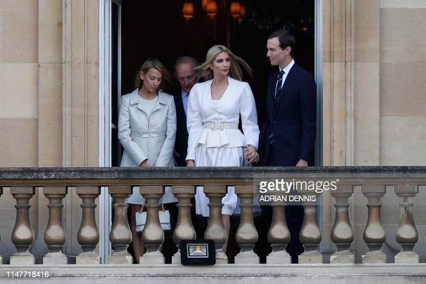 Ivanka Trump and her husband Senior Advisor to the President of the United States Jared Kushner watch from a balcony as the US President Donald Trump...